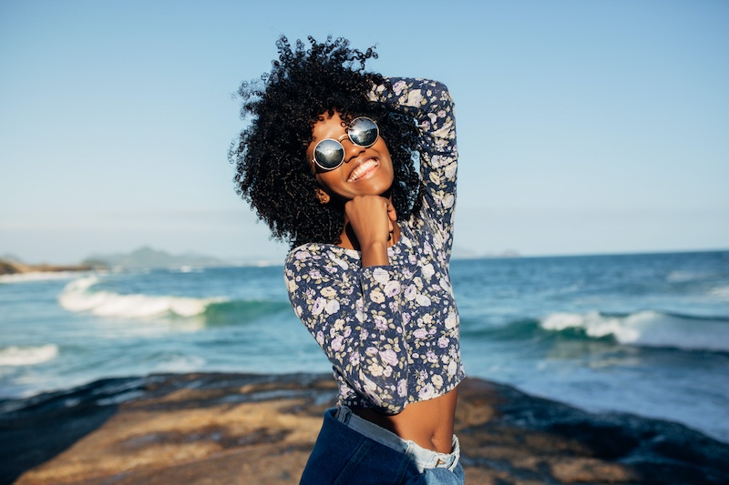 Happy Brazilian woman | 15 Self-Date Ideas For The Solo Woman | Millennial Life | Bonnibelle Chukwuneta