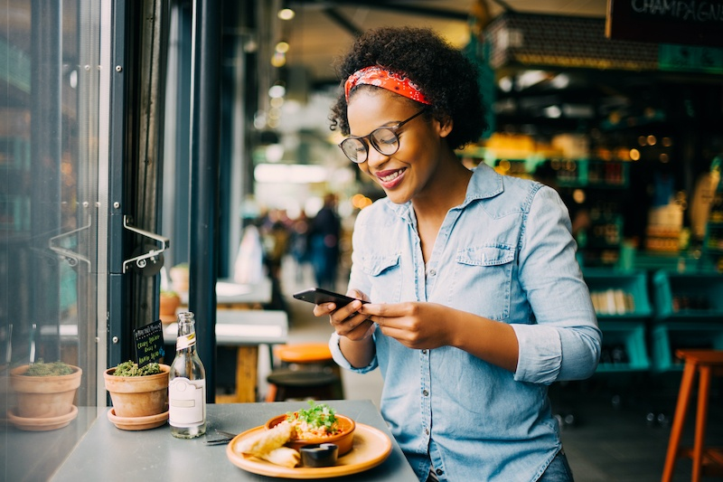 Beautiful African American woman enjoying a solo lunch | 15 Self-Date Ideas For The Solo Woman | Millennial Life | Bonnibelle Chukwuneta