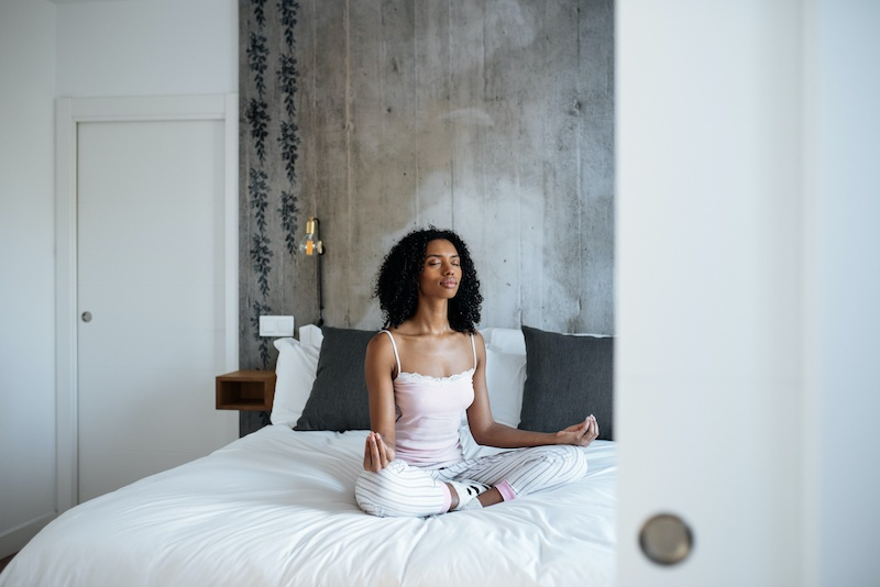 Beautiful woman doing morning meditation | 12 Self-Care Tips To Get You Through A Pandemic